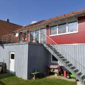 Wohnhaus L. Steinhausen a.d. Rottum Wohnraumerweiterung durch Aufstockung Doppelgarage Holz